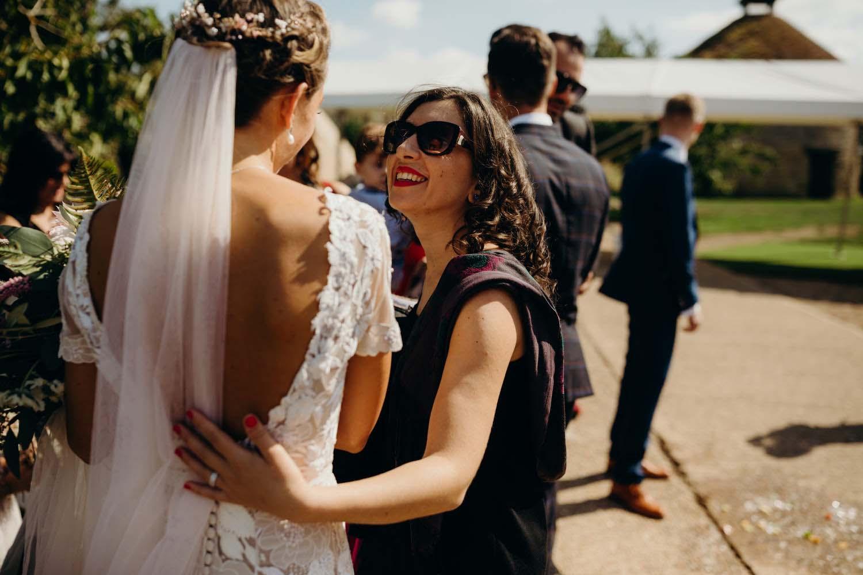 Guest smiles at bride