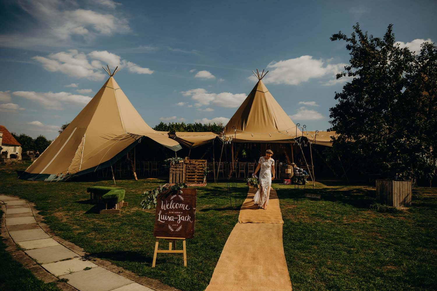 Bride walking out of tipi