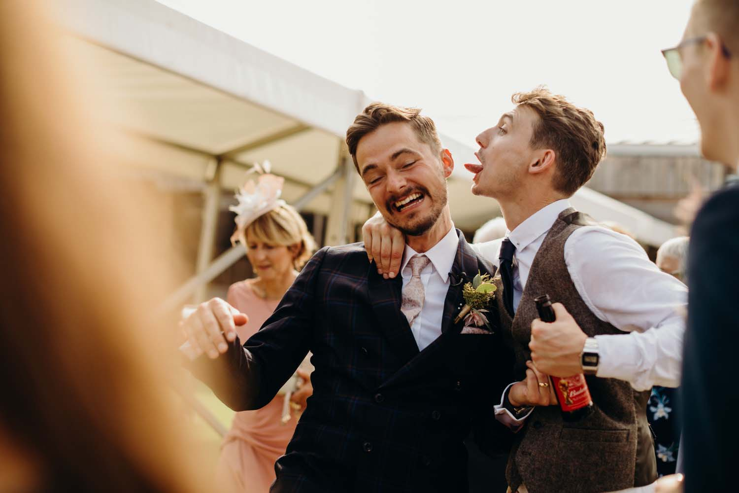 Guest tries to lick groom