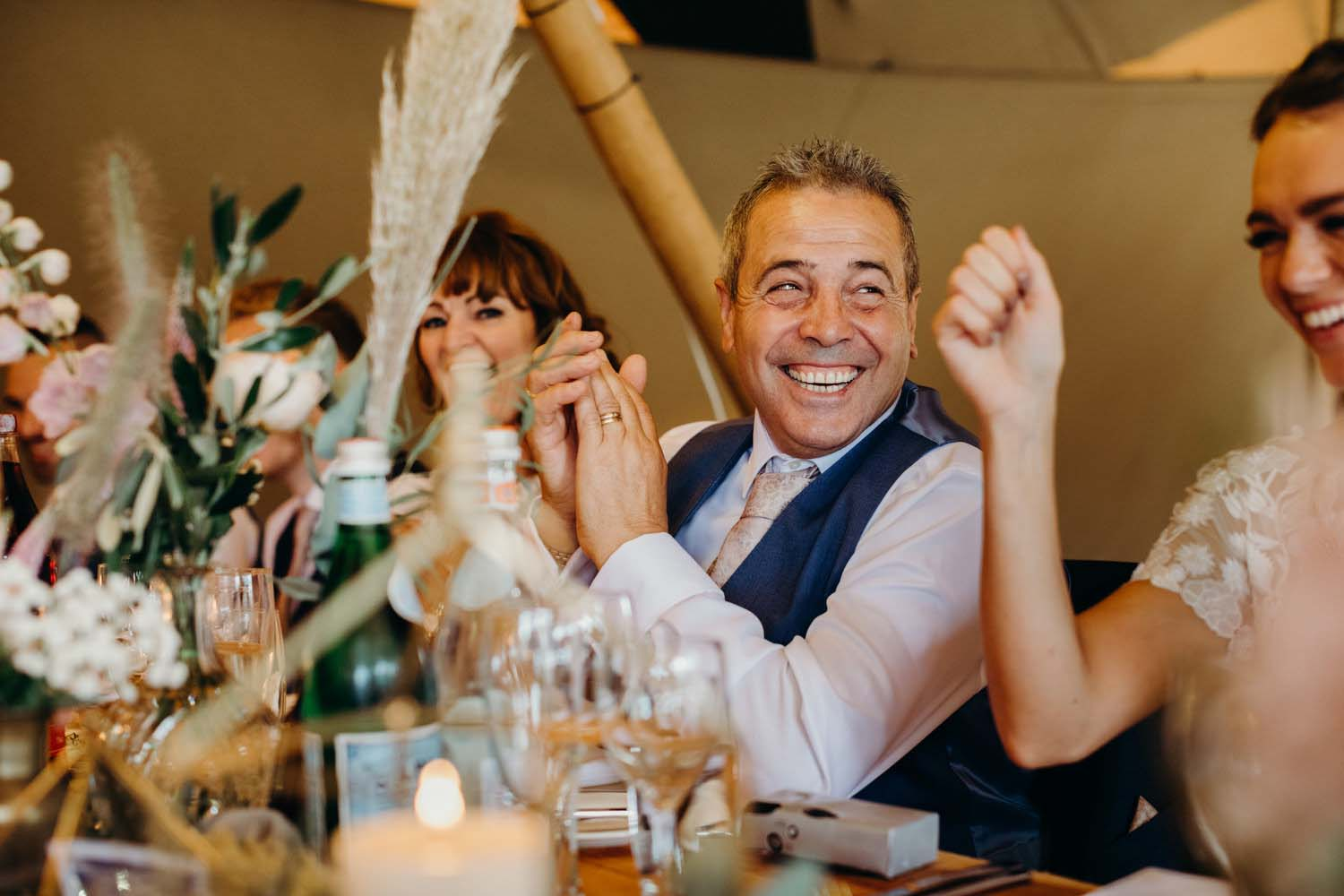 Father of bride clapping