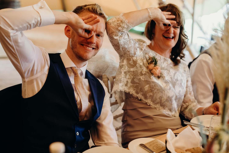 Guests having fun at tipi wedding