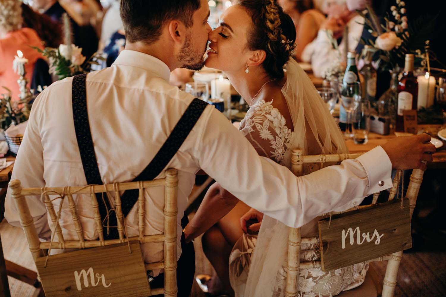 Bride and groom kiss in Tipi wedding