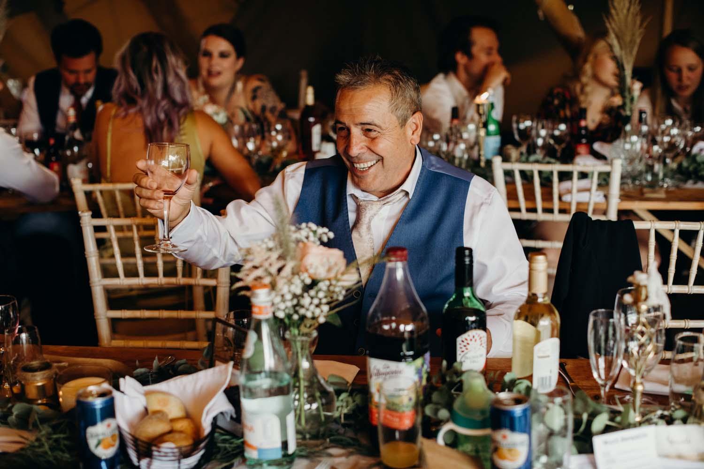 Father of bride raises glass