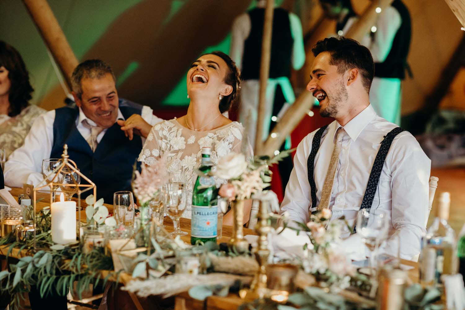 Head table laugh during speeches