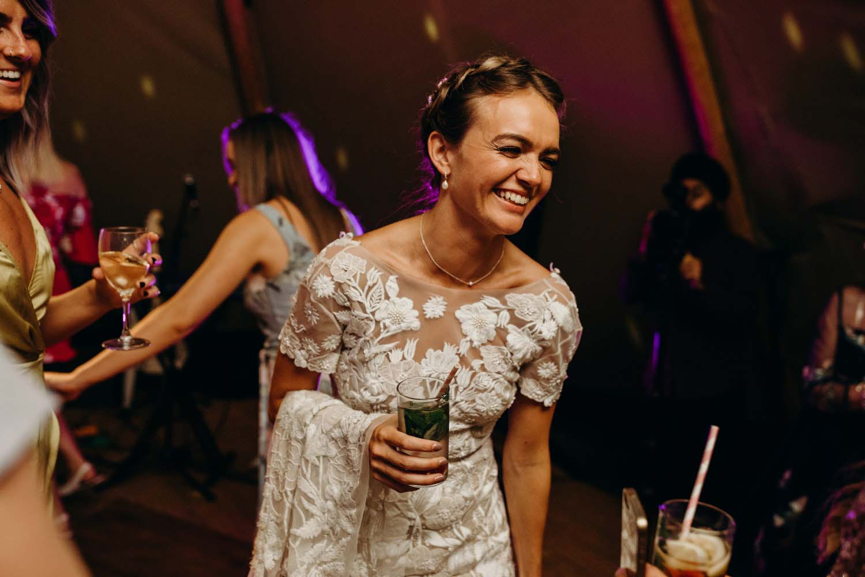 bride smiling at tipi wedding