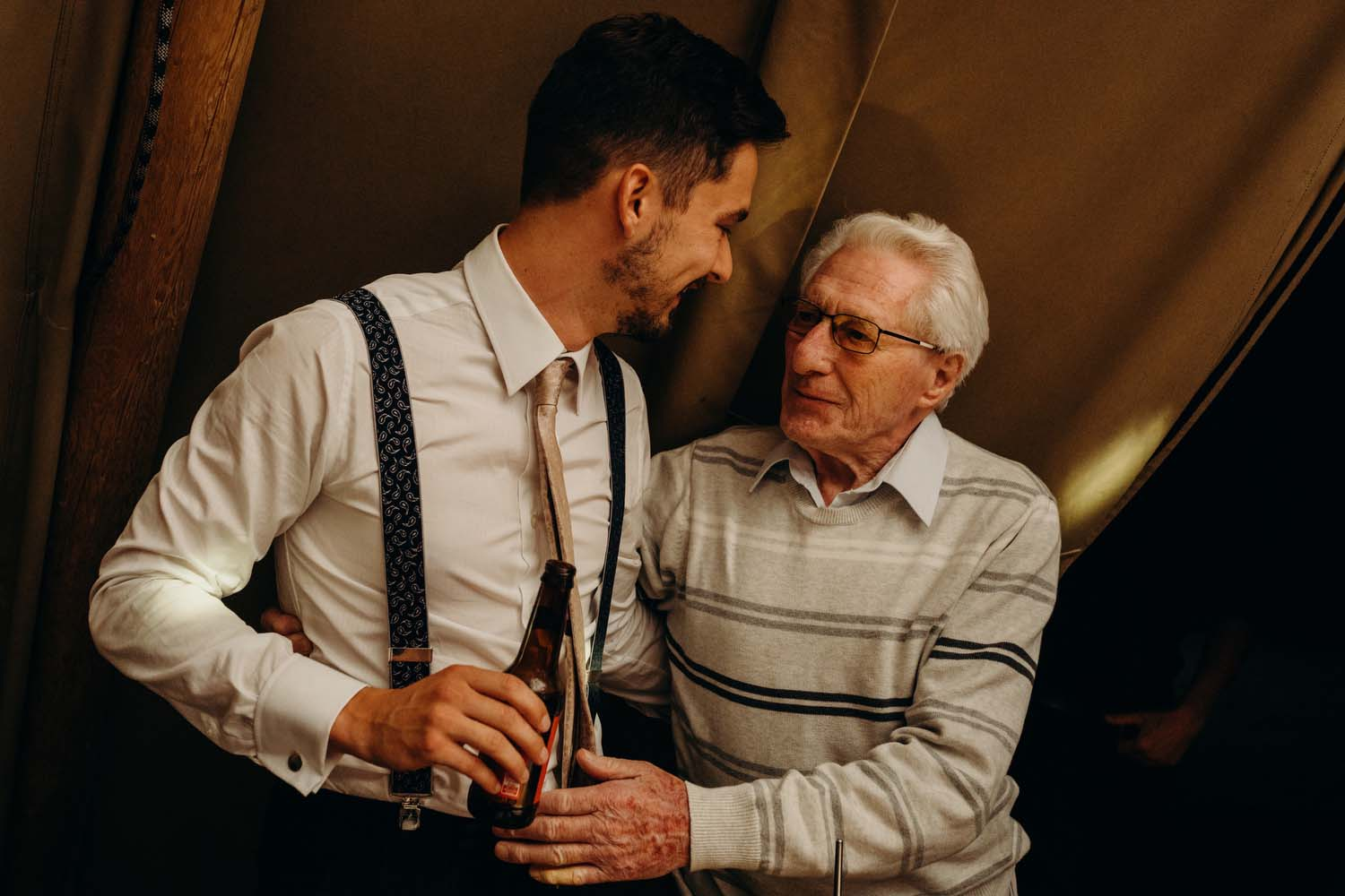groom being hugged by grandfather