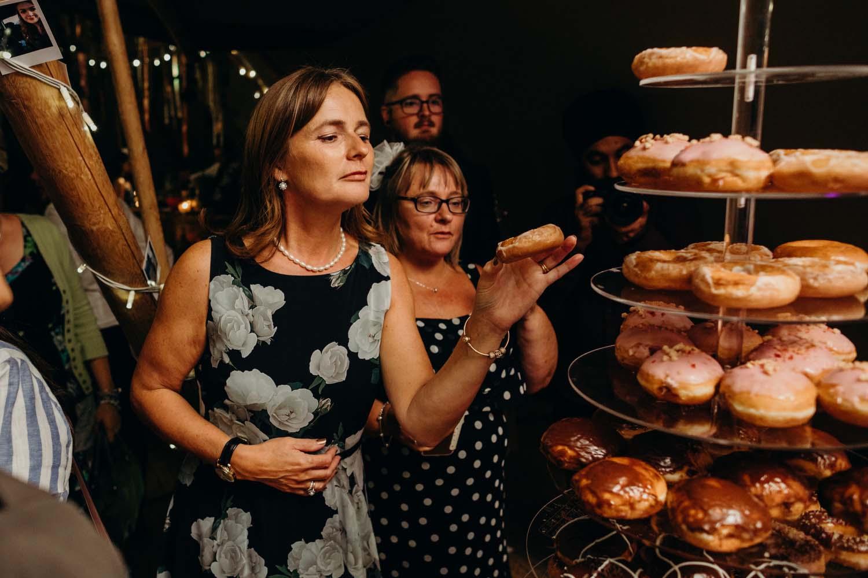 eating donuts at wedding