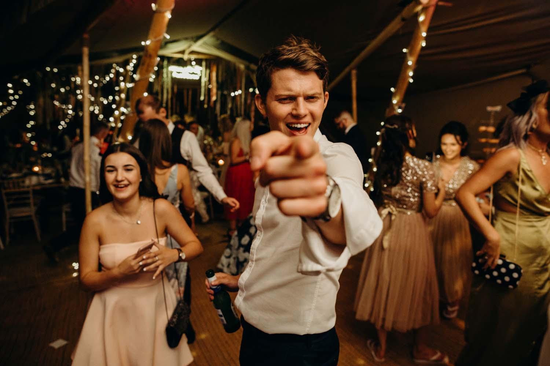 guests points at camera