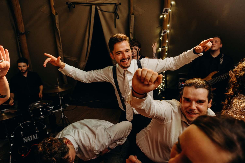 groom dances with guests