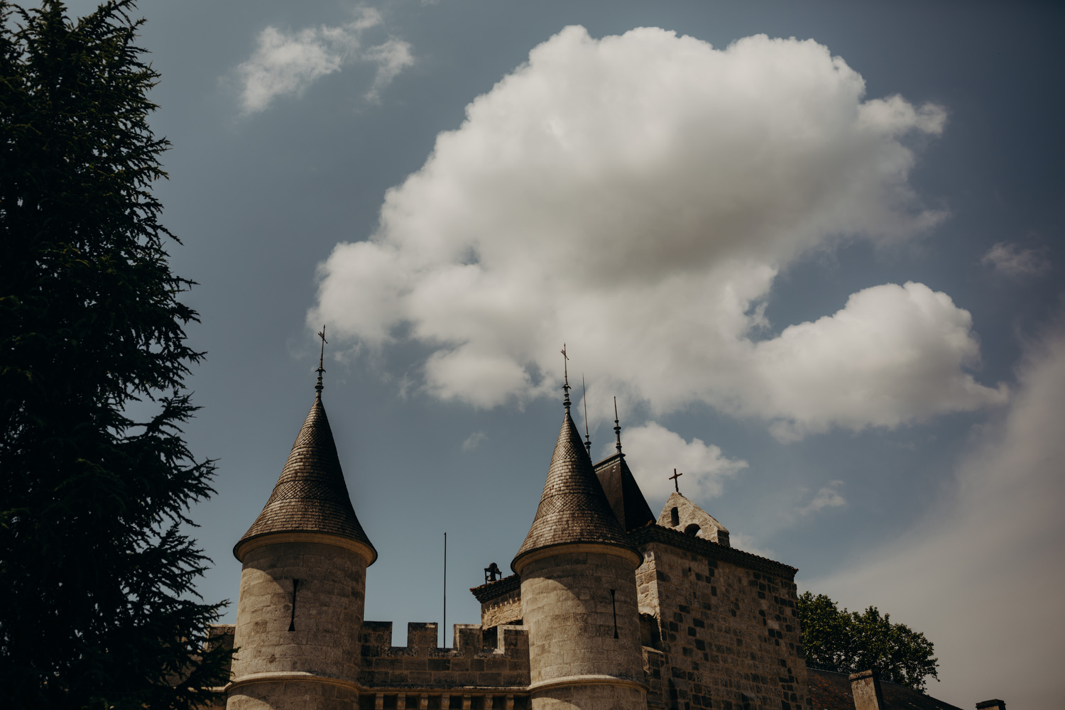 Turrets of chateau de lisse with clouds in background