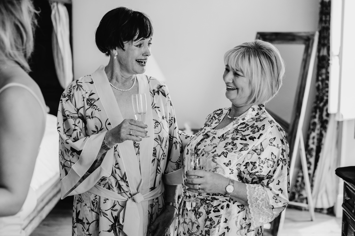 mother of the brides drinking champagne