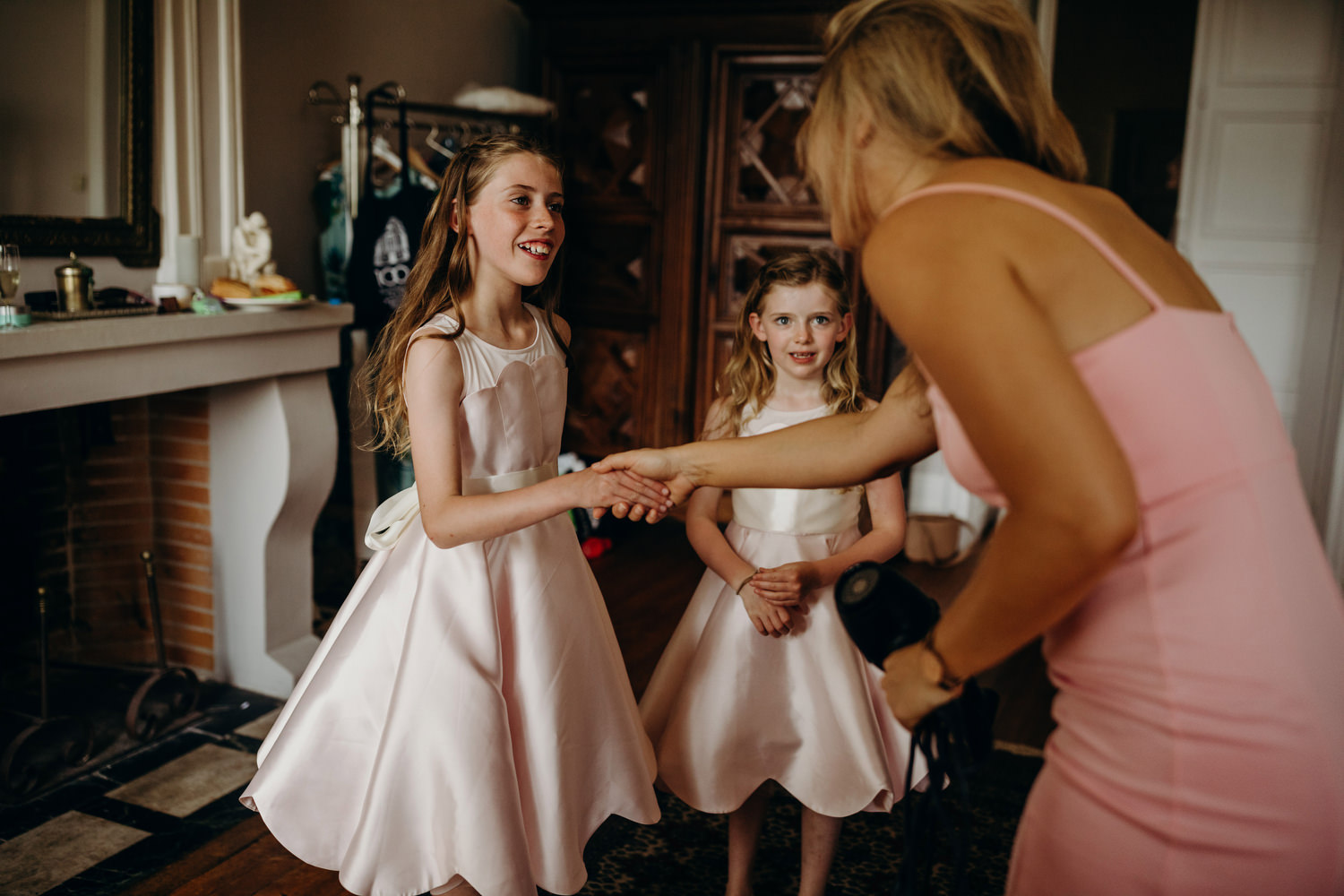 guest shaking hands with flower girls
