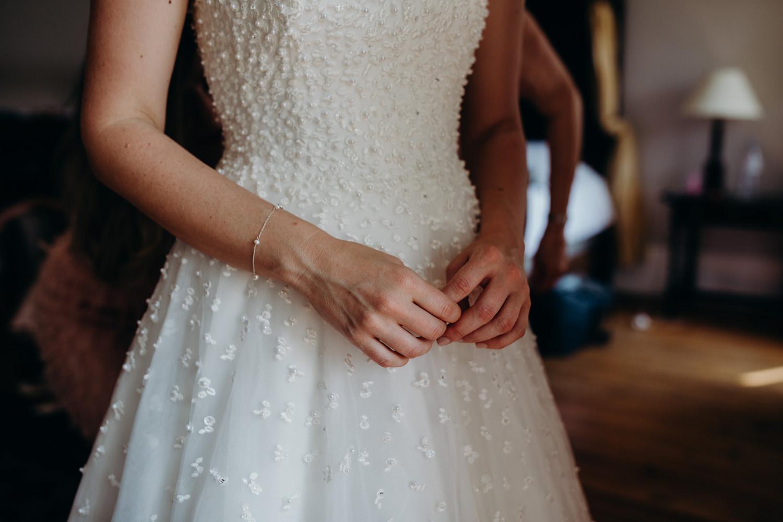 detail shot of Sassi holford dress