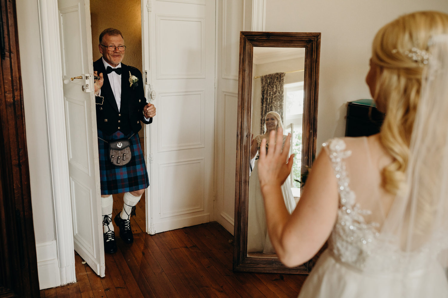 father of bride sees daughter in dress