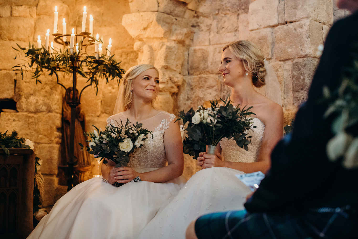 brides looking into each others eye during ceremony