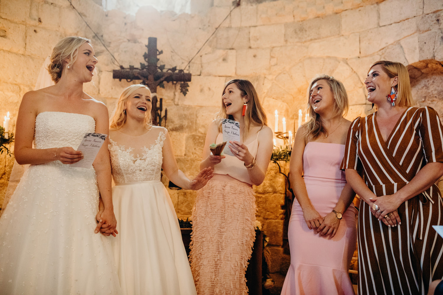 brides and friends sing during ceremony