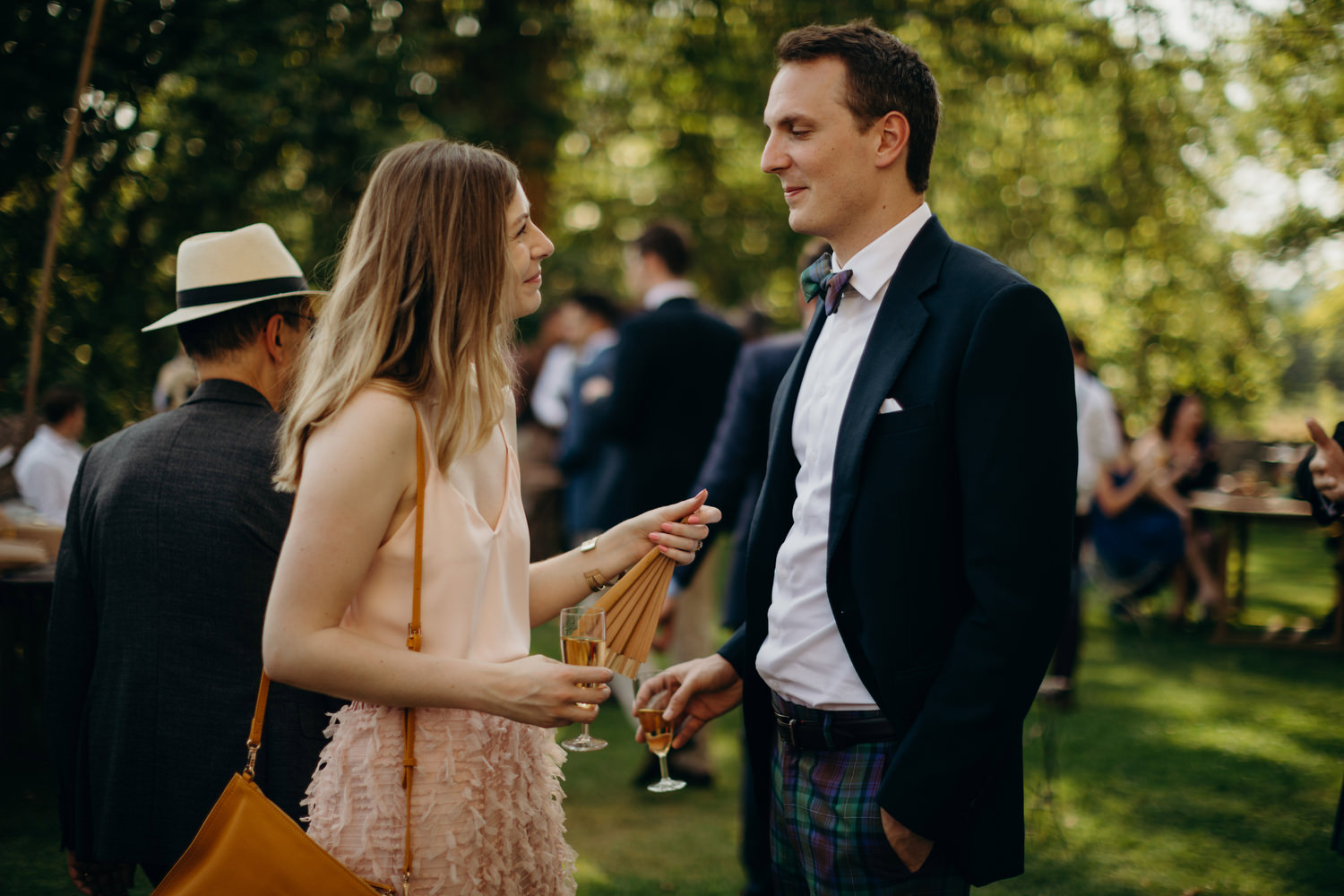 wedding guests look lovingly into each others eyes