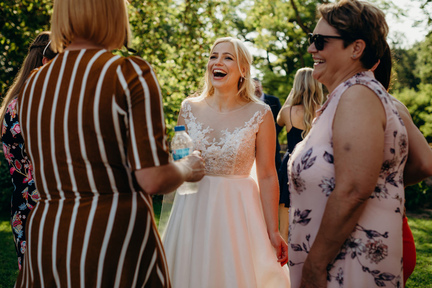 laughing bride chats to guests