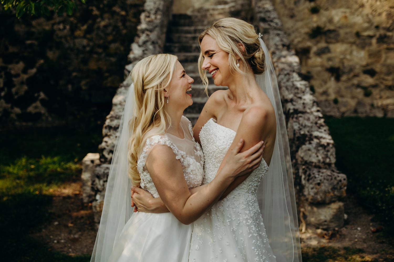 two brides embrace