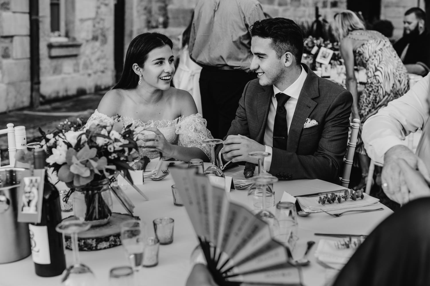 black and white image of wedding guests