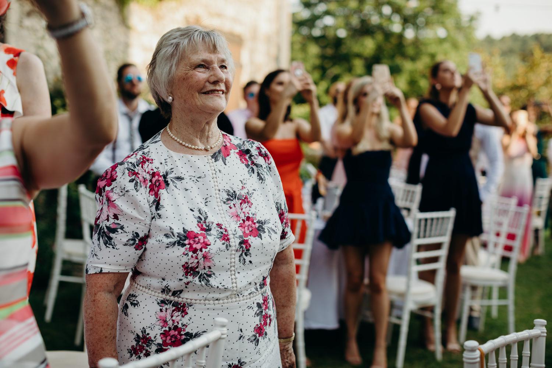 grandmother watching brides sing