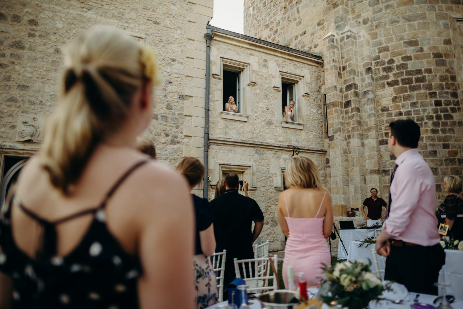 Brides perform song from windows of chateau