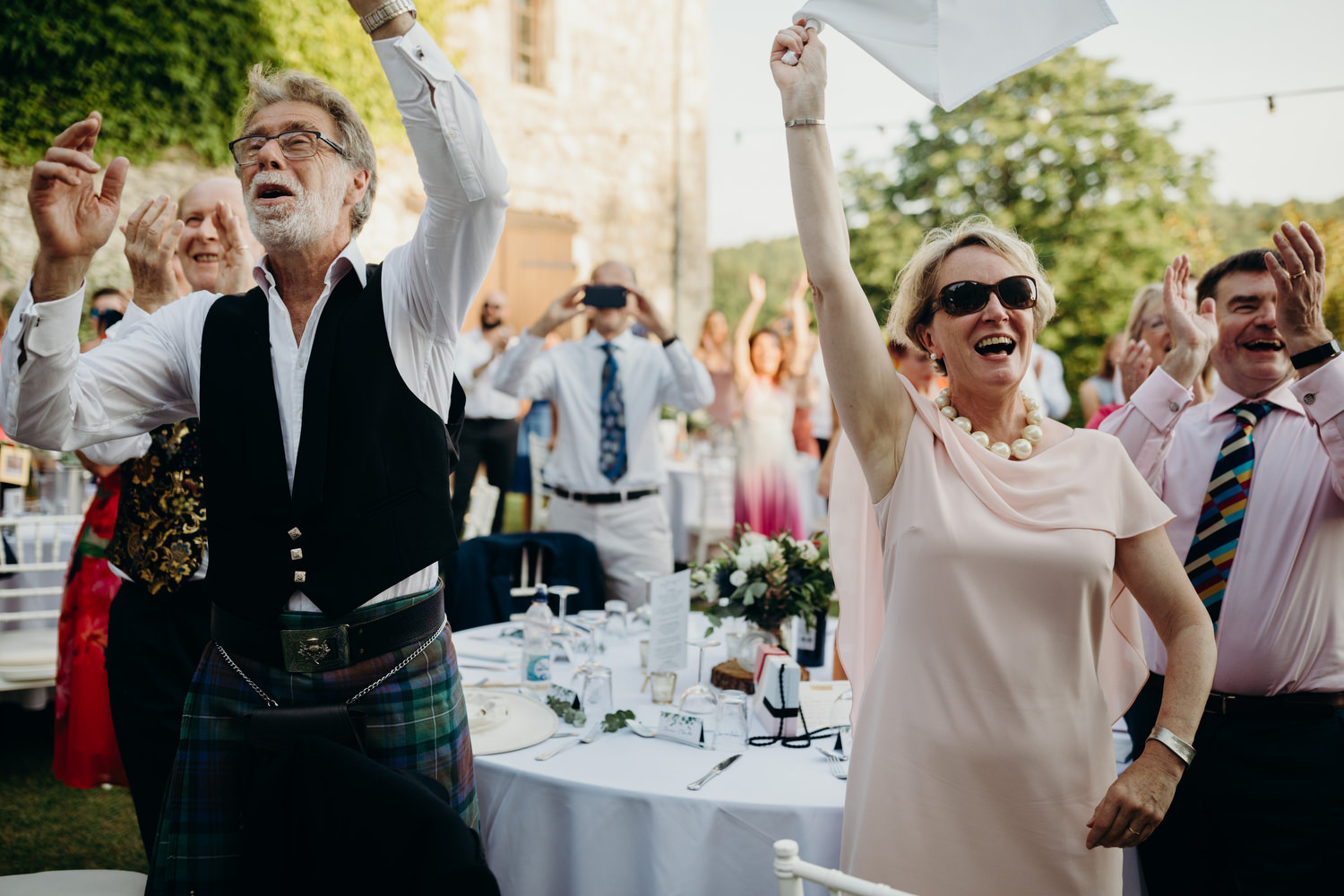 Guests waving their napkins in the air