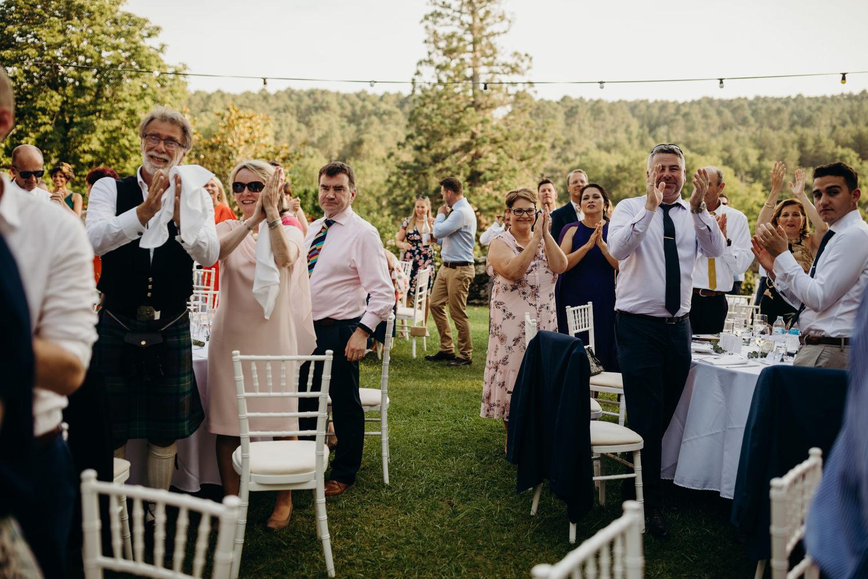 wedding guests clap during brides entrance