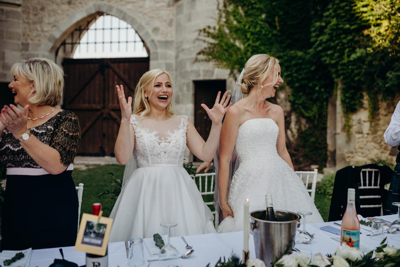 brides making entrance at chateau wedding