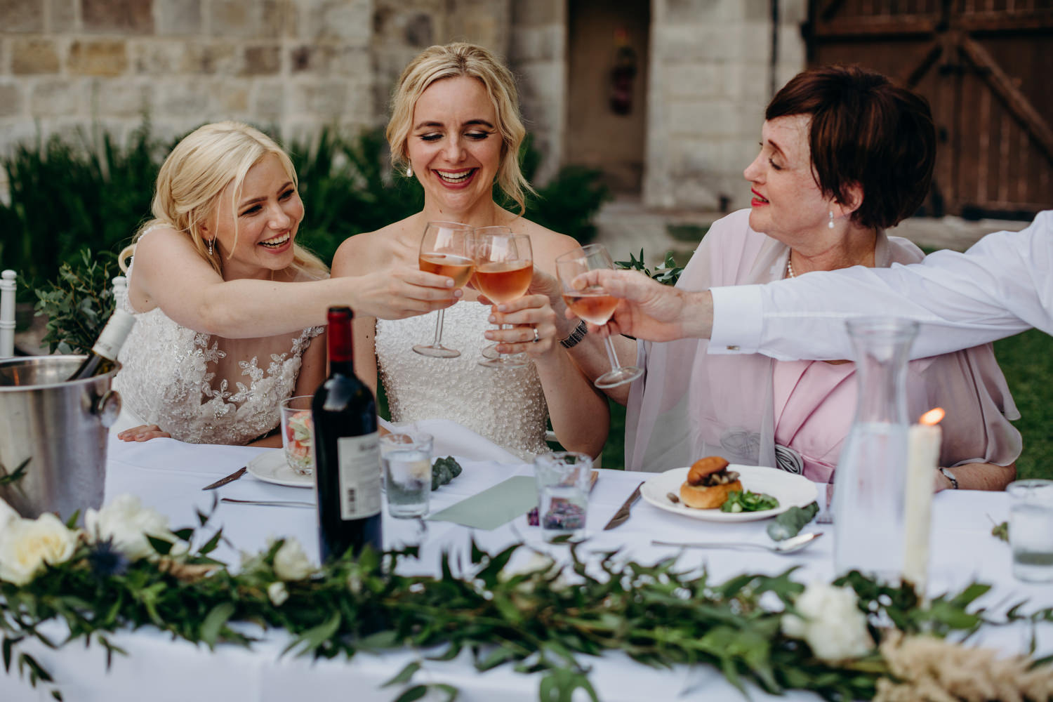 brides cheers with family