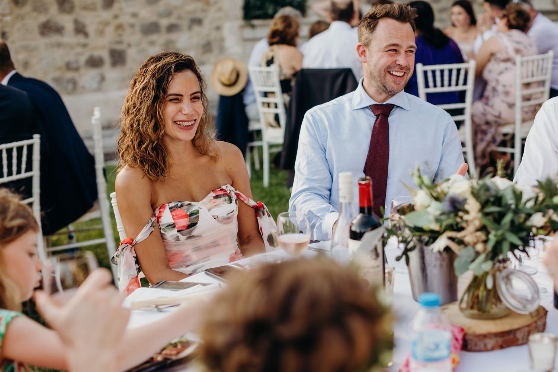laughing people at wedding
