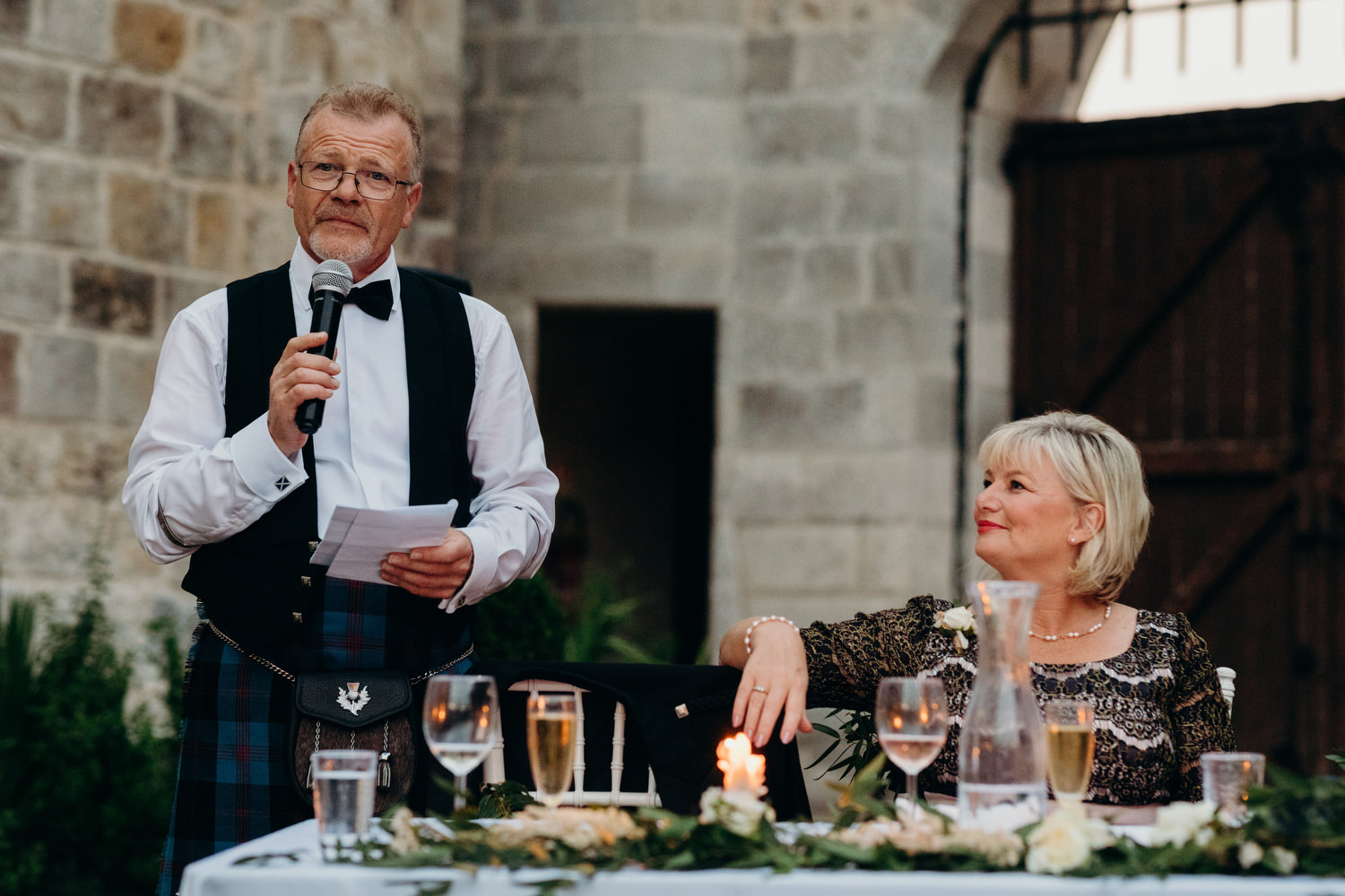 Father of bride speech with wife looking at him
