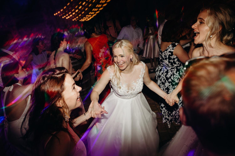 bride doing a ceilidh dance