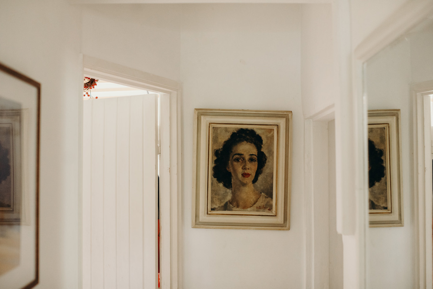 painting of lady in white hall