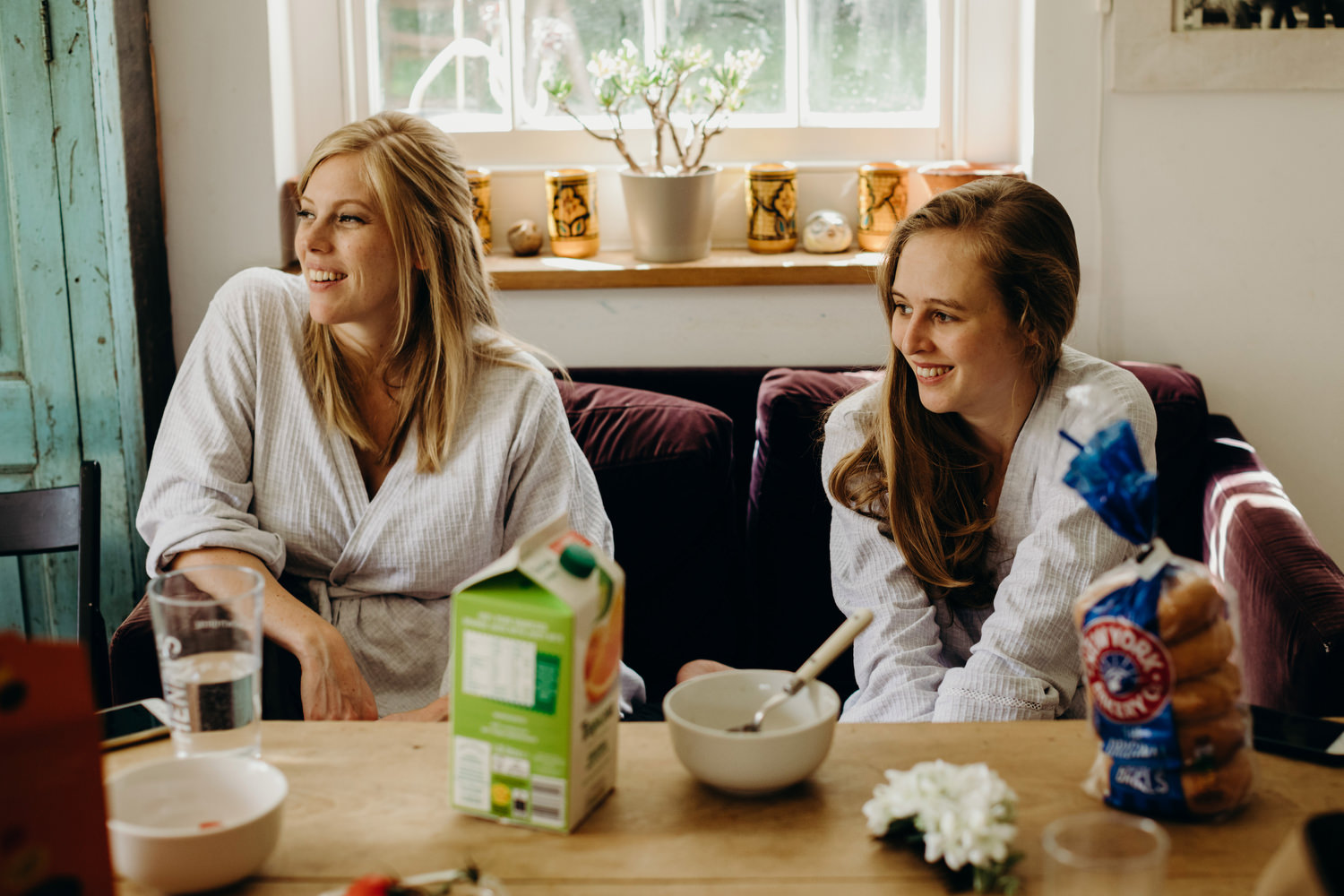 bridesmaids smiling at the breakfast table
