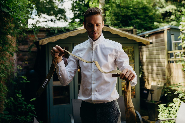 groom getting ready in garden