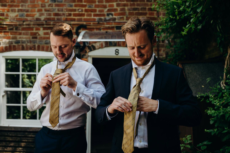 ushers put ties on