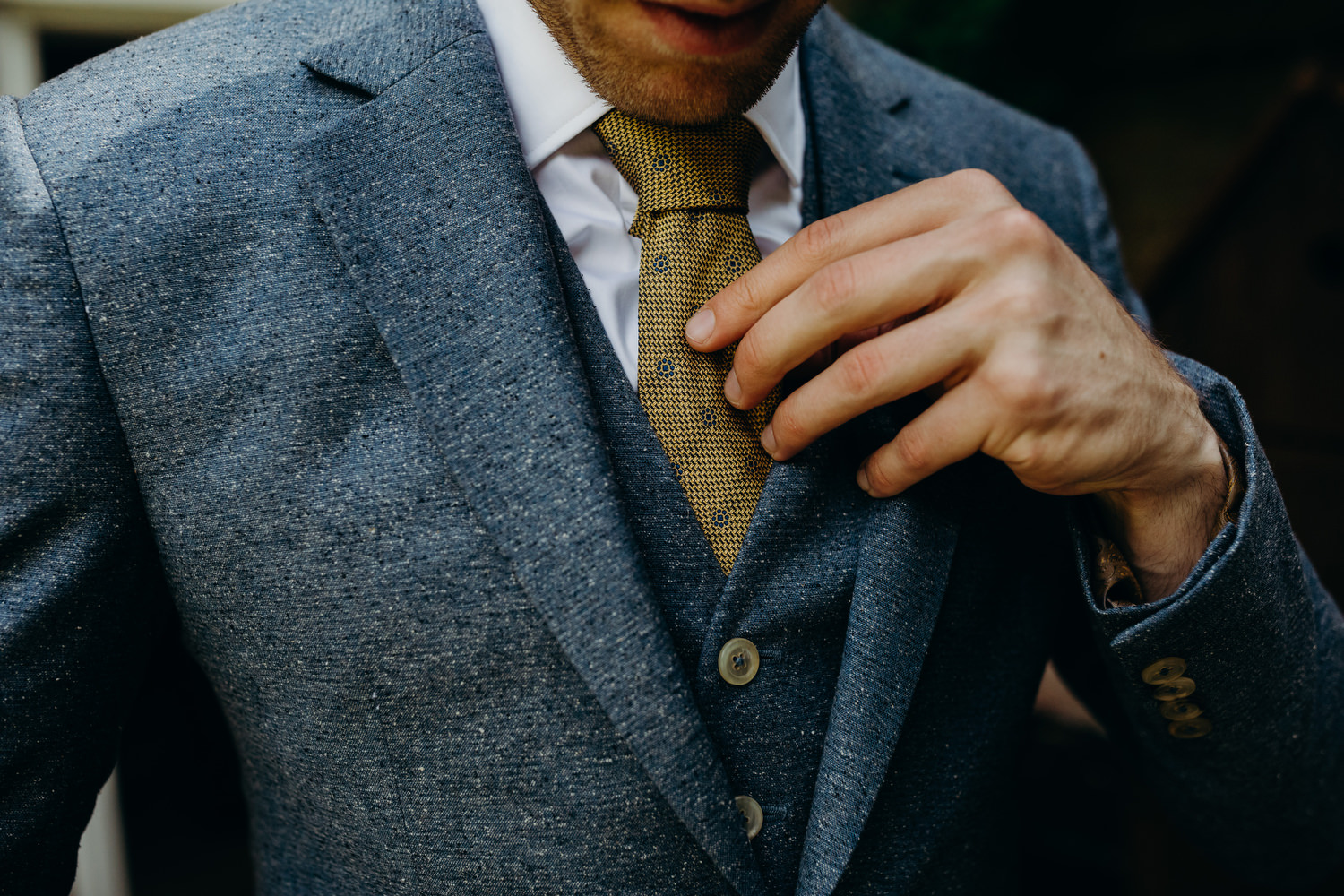 detail photograph of groom's suit