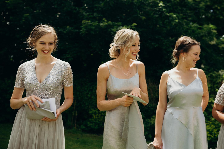 smiling bridesmaids opening gifts