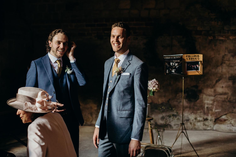 groom smiling at barn wedding