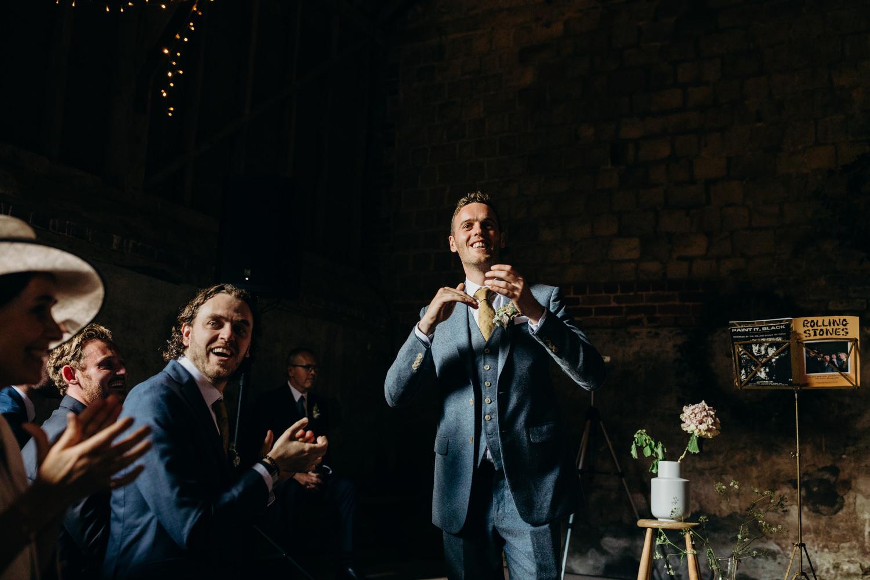 groom claps before wedding