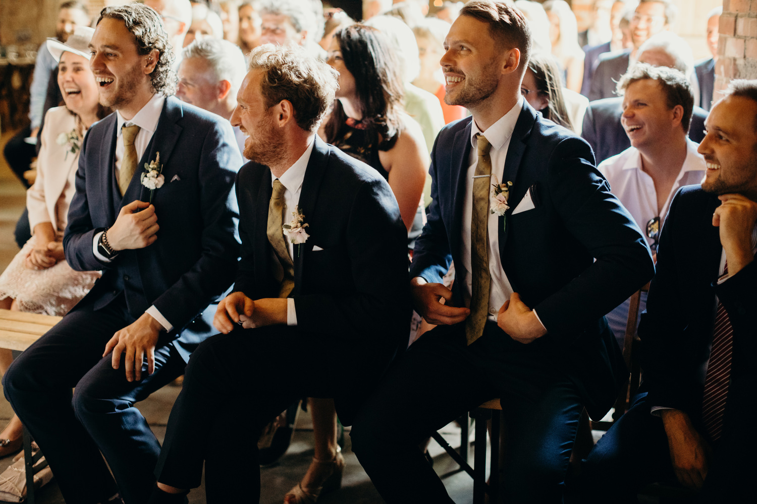 ushers laughing during ceremony
