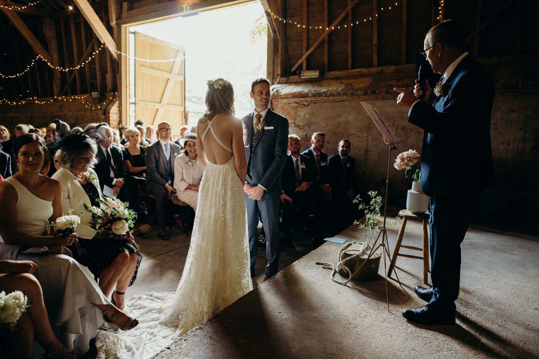 wick bottom barn wedding ceremony