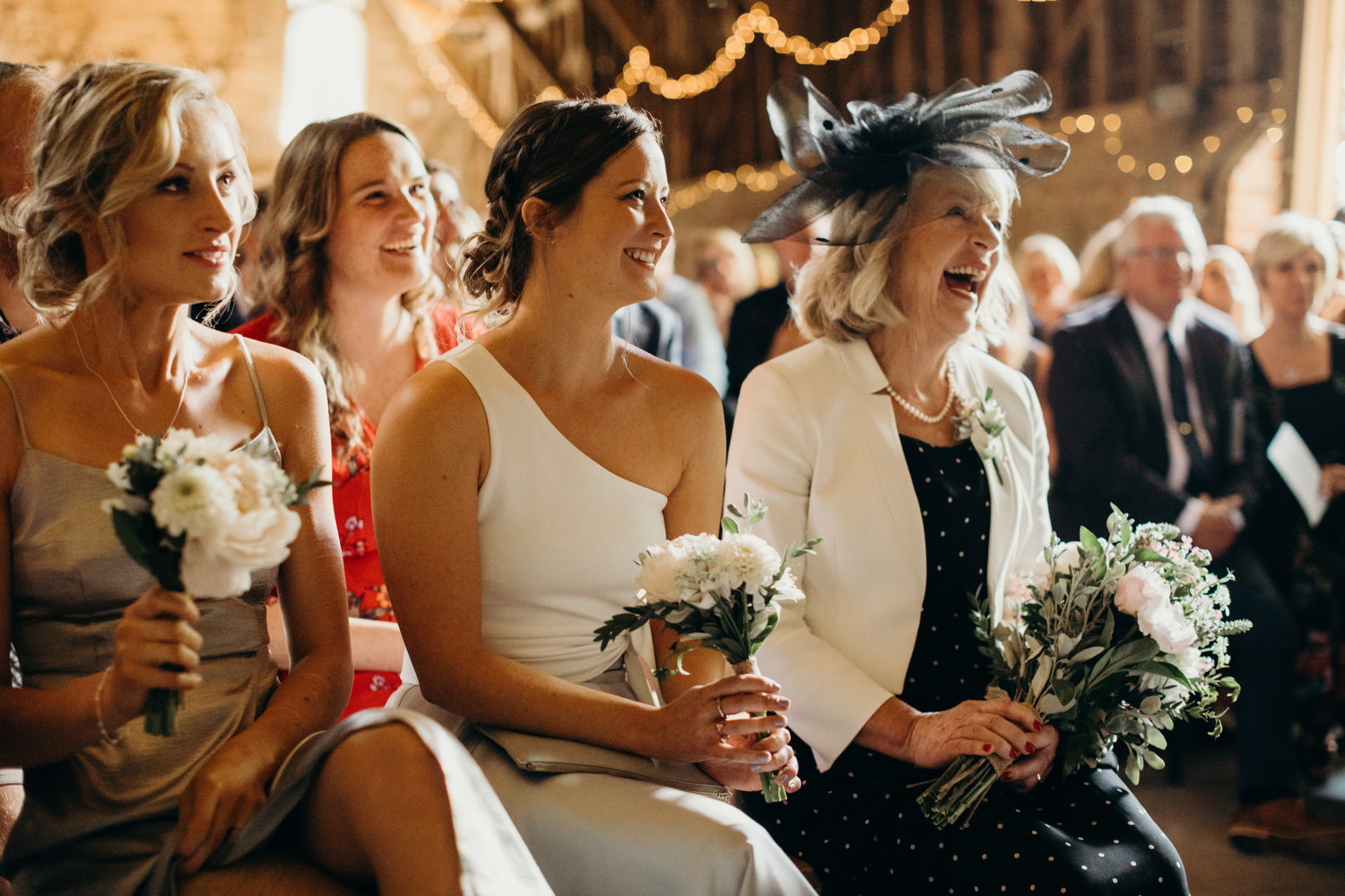guests laughing during vows