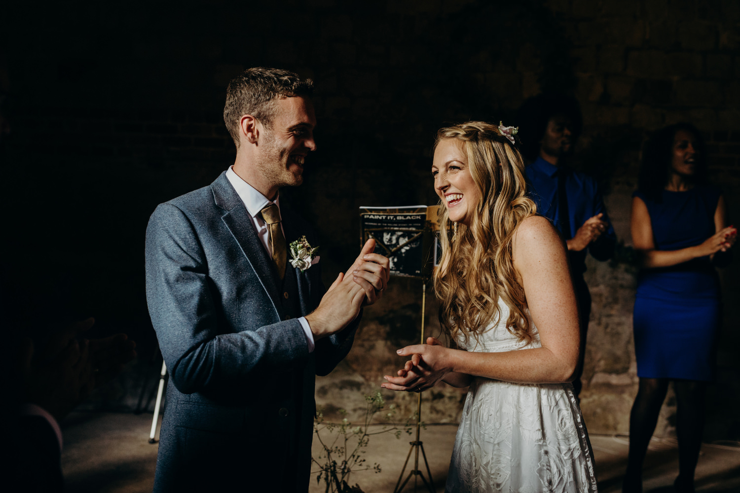 bride and groom smiling during ceremony