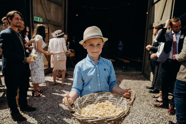 page boy holding confetti
