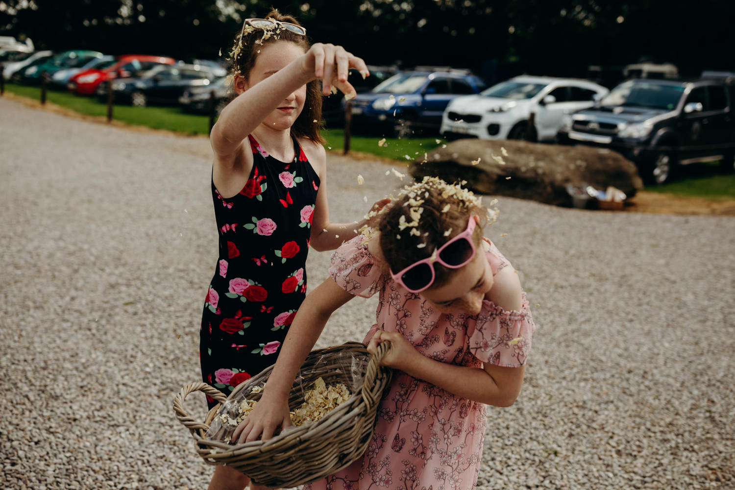 girls shower each other with confetti