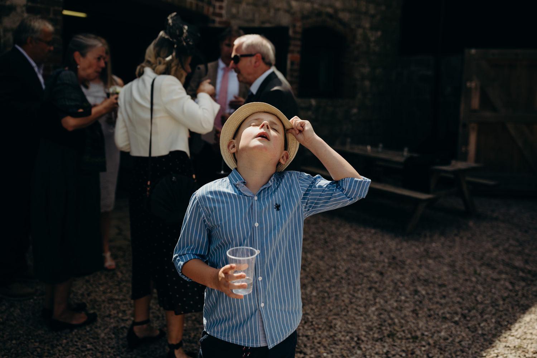 kid at hot wedding