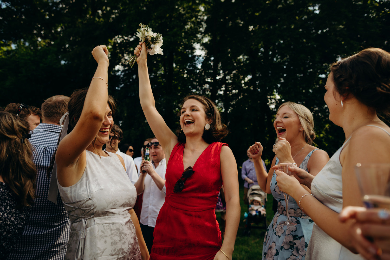 lady in red catches bouquet
