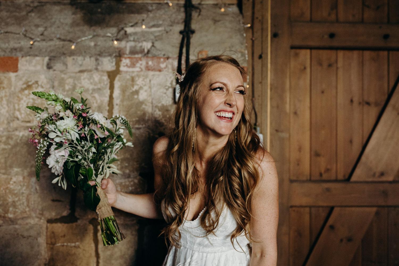 bride holding bouquet smiling
